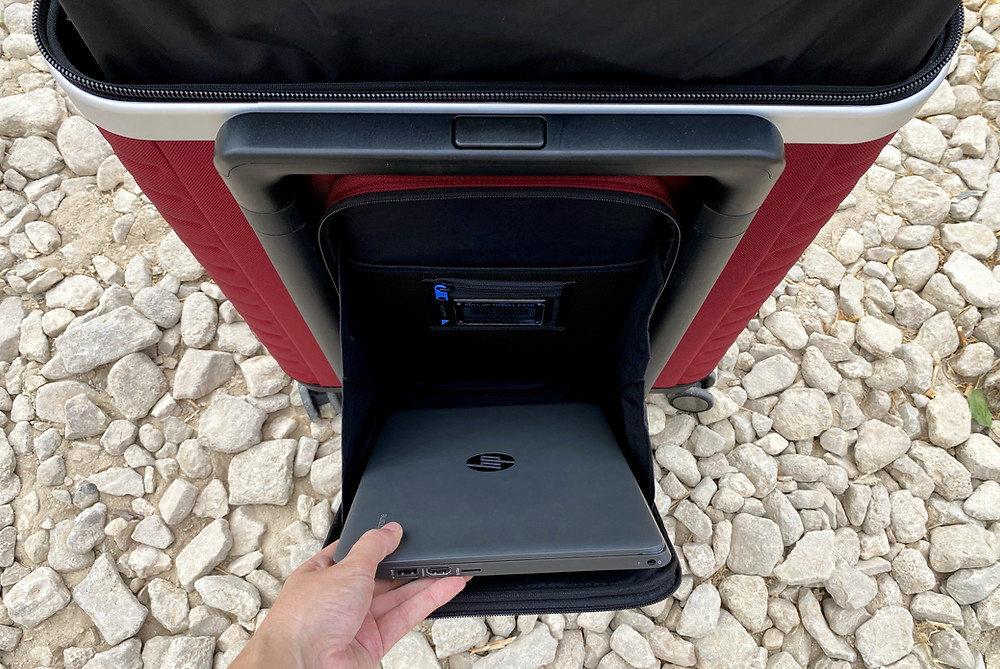 Laptop compartment on the Pull Up Suitcase, opened showing laptop in Ronda, Spain