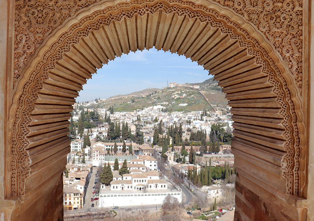 View from a decorative window inside the Alhambra of Granada below, Spain