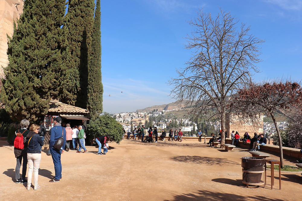 Area between the palaces and the fortress at the Alhambra where people can sit and eat, in Granada, Spain