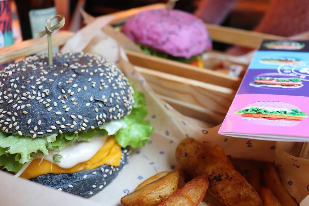 Vegan burger with colourful buns, Milan Italy