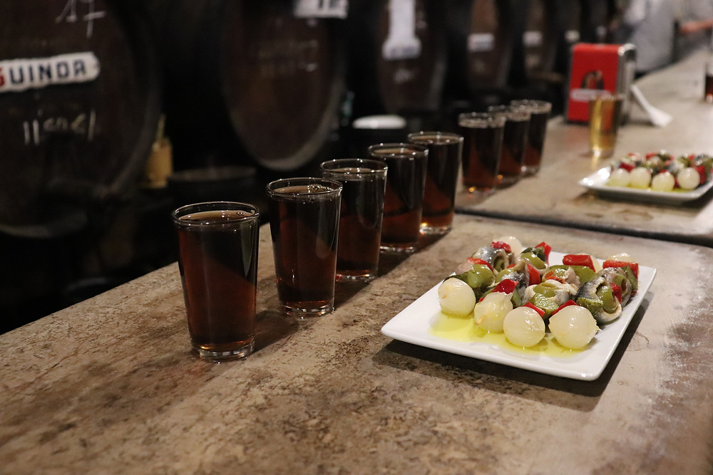 Sherry shots and tapas selection in oldest bar in Malaga Spain