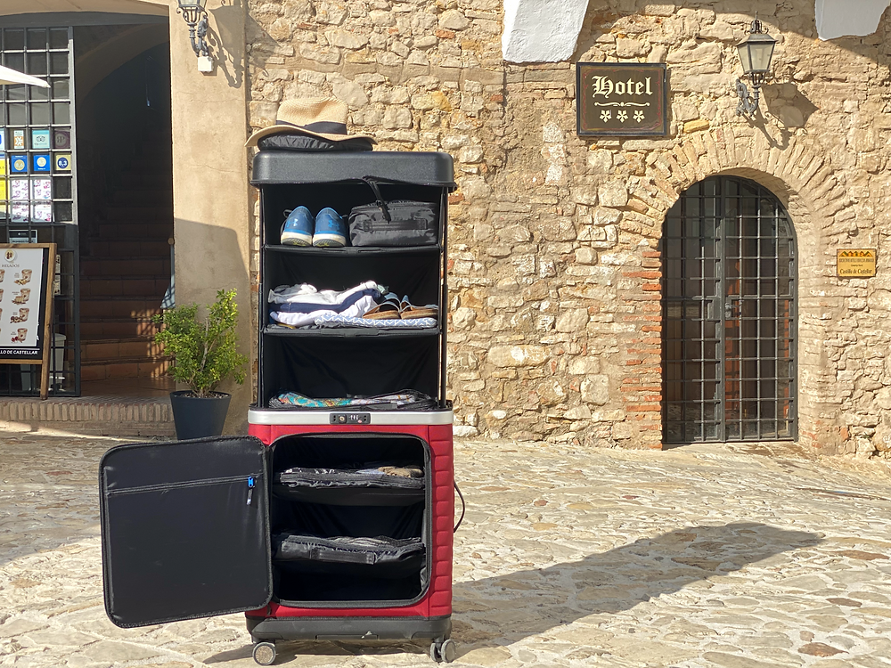 Pull Up Suitcase opened showing its six expandable shelves in Castillo de Castellar, Spain