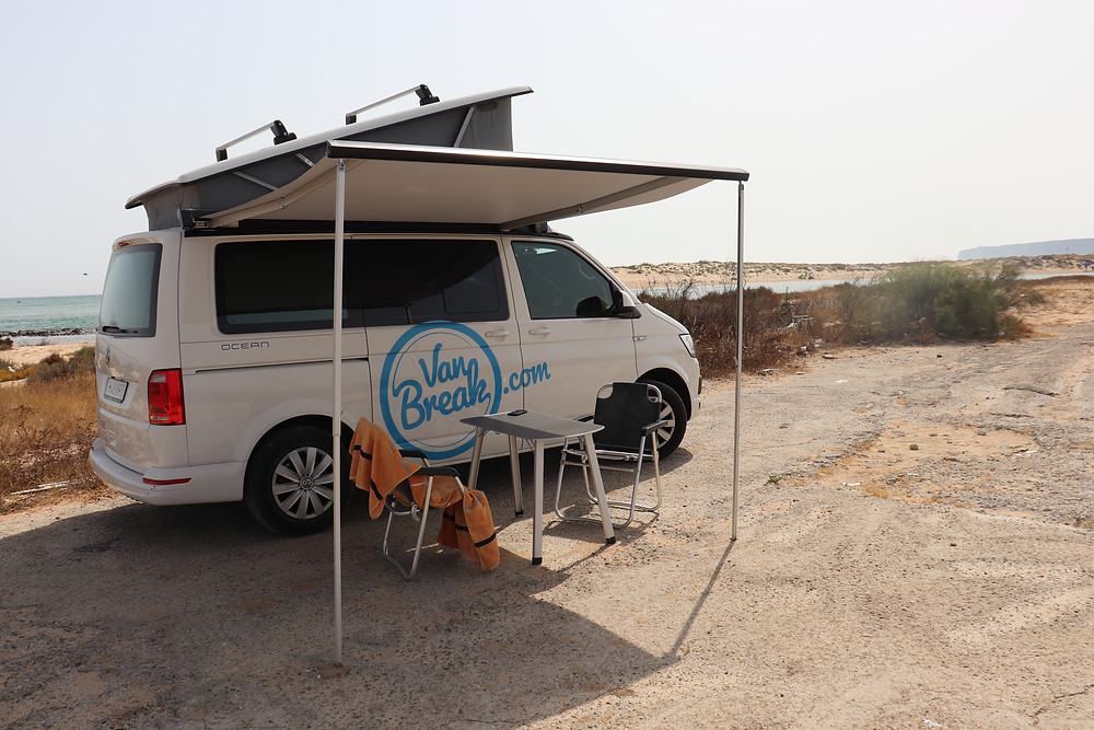 Van parked and set up at the beach in southern spain