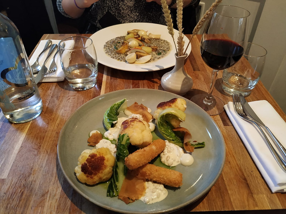 Acorn Restaurant vegetarian dishes with red wine in Bath, England