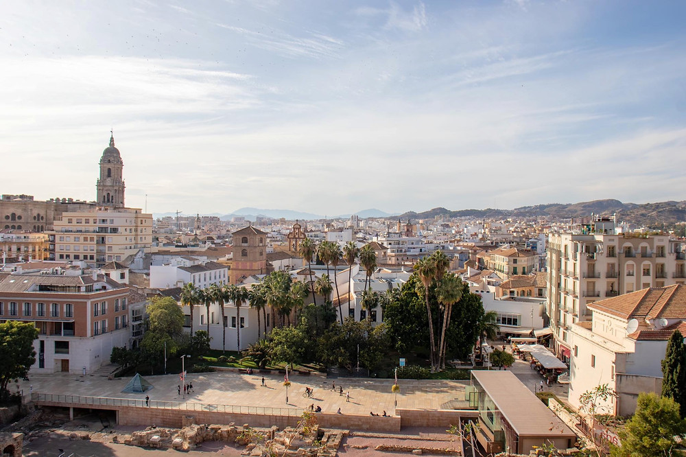 View of the city centre of Málaga showing the roman ruins, the city, and the cathedral in the forefront.