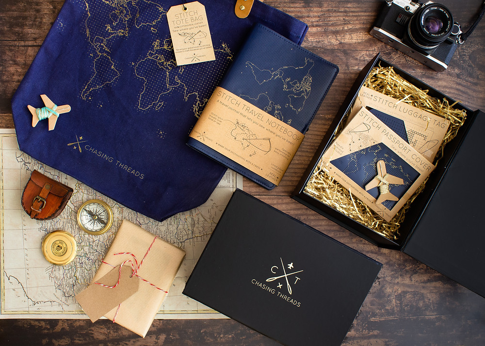 Set of sew your own travel accessories including a passport cover, tote bag, and notebook from Chasing Threads in navy
