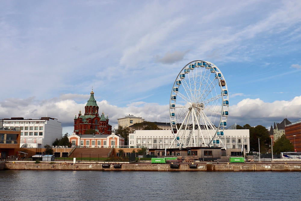 View of market square and the ferris wheel in Helsinki Finland from the water