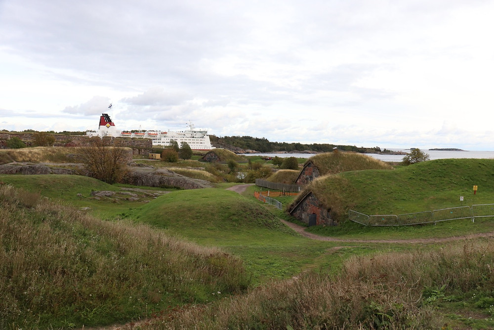 Landscape of Suomenlinna, Helsinki Finland with cruise ship in the background