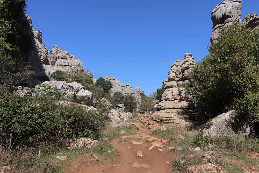 Dirt path in between the limestone karst rock formations at El Torcal.