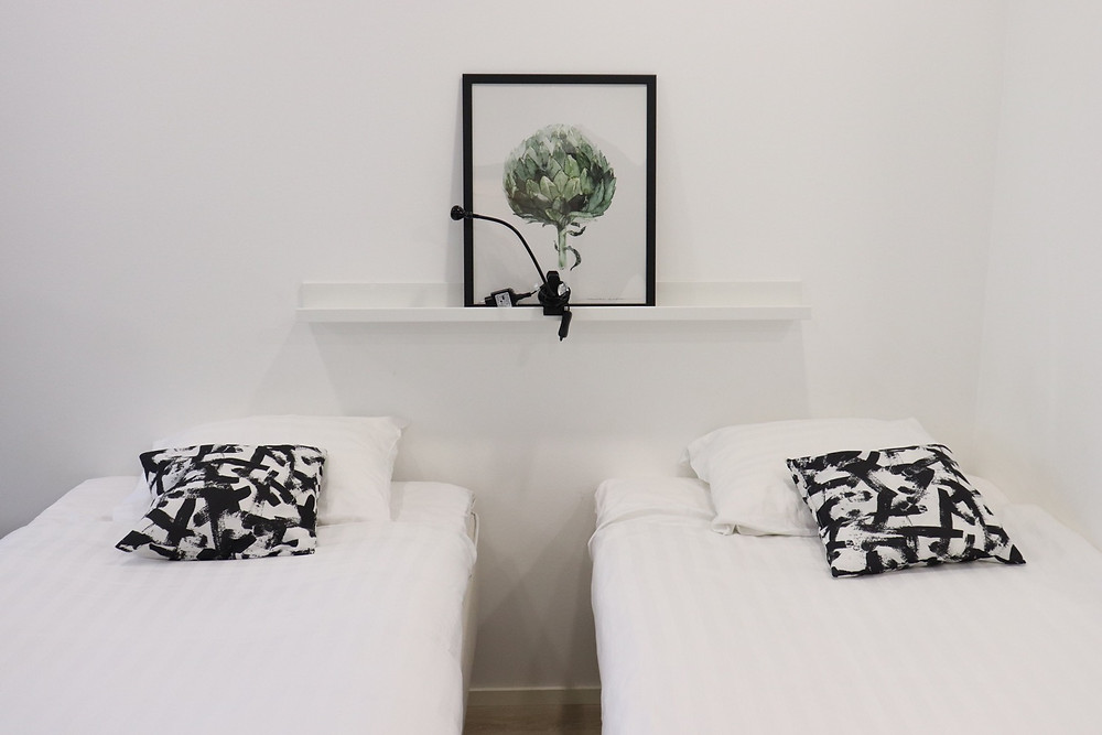 Two twin beds with white decor in the apartments in Haaga, Helsinki Finland