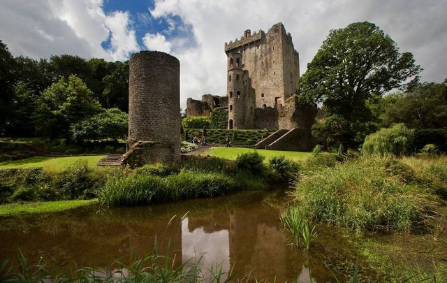 View of Blarney Castle and tower from the pond in Ireland