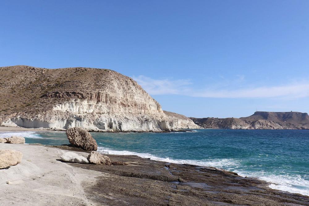 View of Cala de Enmedio and the white cliffs in Almeria, Spain