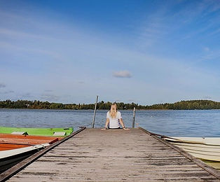 Sitting on the dock at Lake Tuusula, Finland