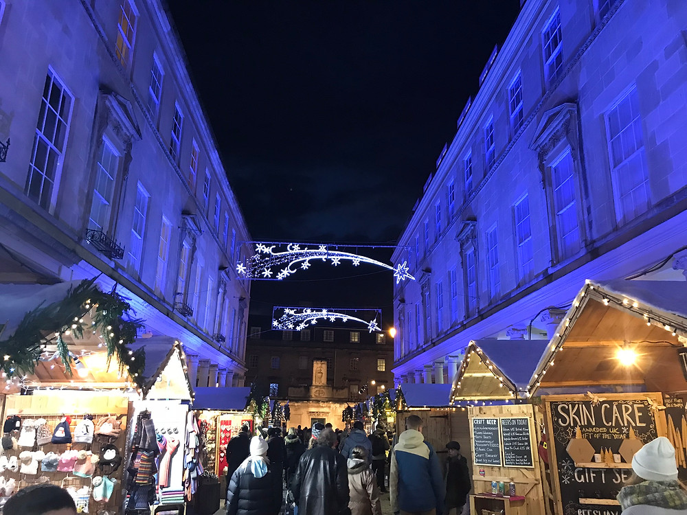 Bath Christmas market at night with blue lights in England