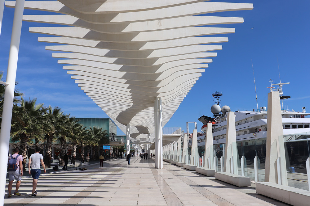 Port of Malaga walking path with cruise ship docked Spain