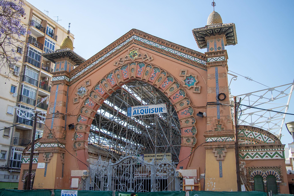 Historic market with an Arab arch with scaffolding around it.