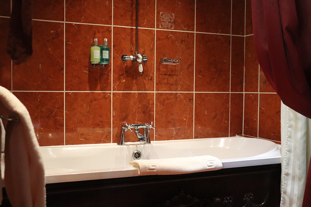 Bathtub with towels inside lumley castle hotel northern england