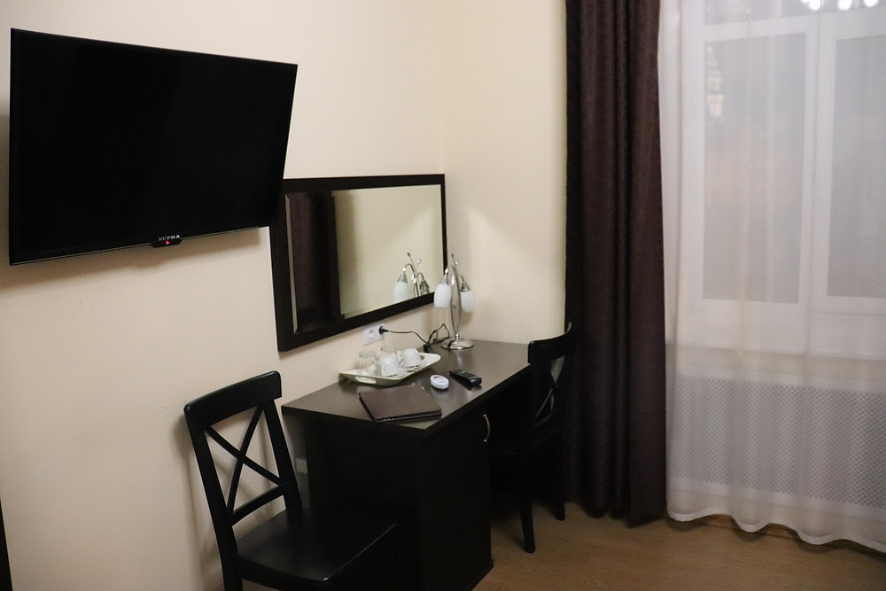 Desk and television in double bedded room hotel esplanada russia