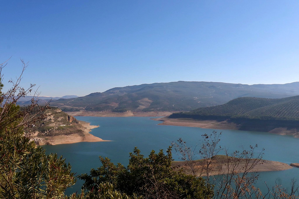 View of the reservoir and mountain ranges in Iznajar from the viewpoint high on a hill.