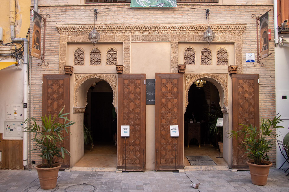Outside entrance to the Arab baths with two Arab arches as doors.