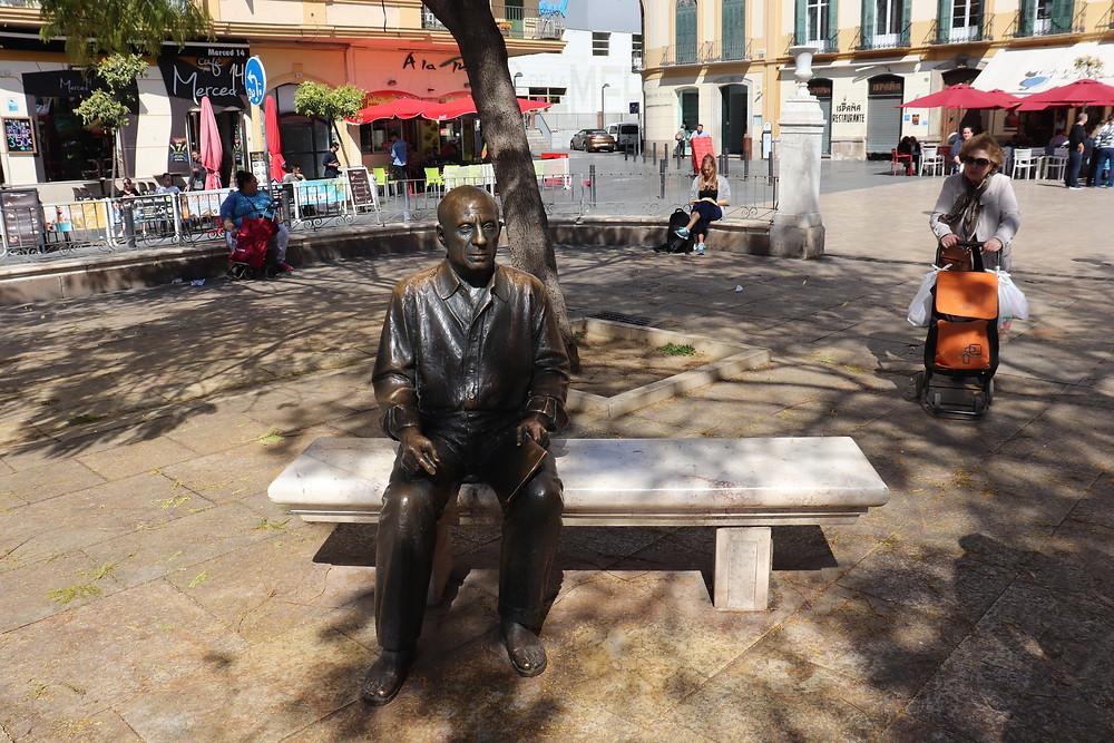 Picasso statue sitting in Malaga plaza, Spain
