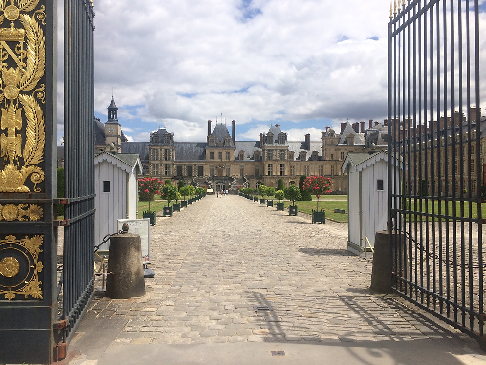 Entrance gates to Fontainebleau palace in Paris, France