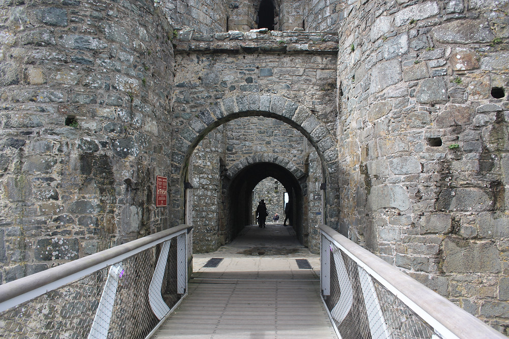 Harlech Castle entrance over the bridge in Wales