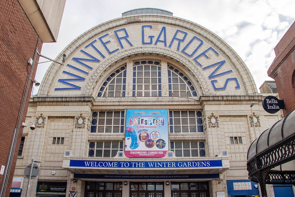 Blackpool Winter Gardens entrance with a curved roof and white tiled walls.