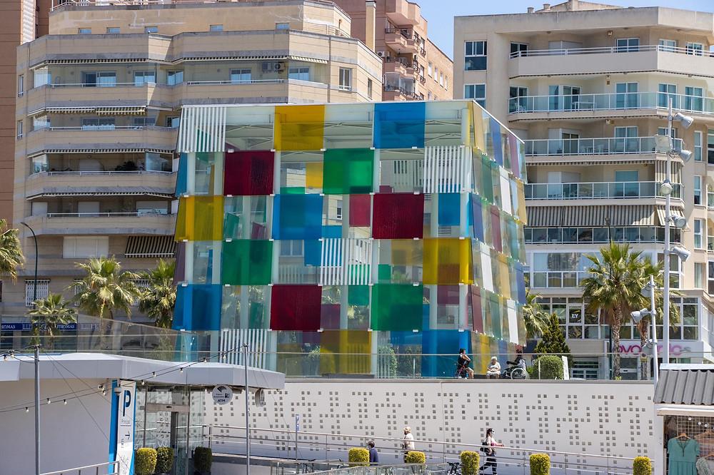 Multi coloured glass cube building.