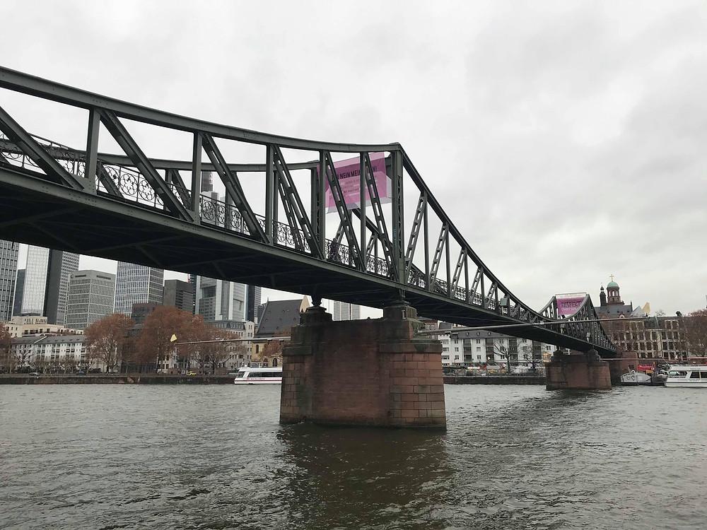 Eiserner Steg bridge crossing the river in Frankfurt Germany