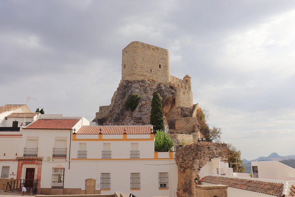 Castillo de Olvera with dark clouds around it in Spain