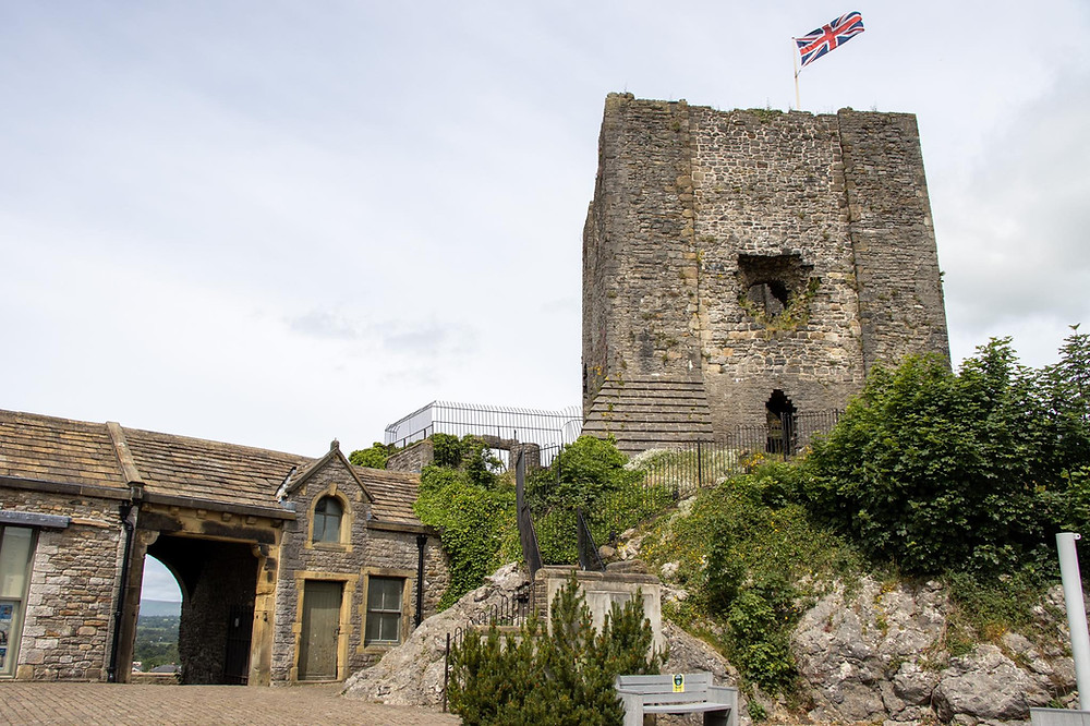 View of a medieval tower from a castle with the Union Jack flag on the top.