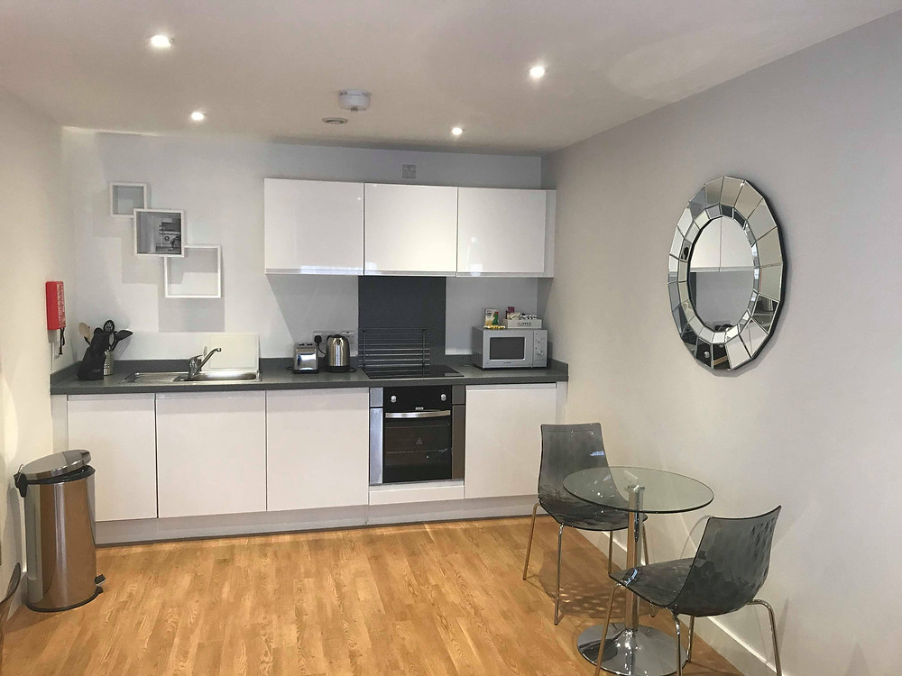 Kitchen and dining area inside SACO Apartments Manchester England