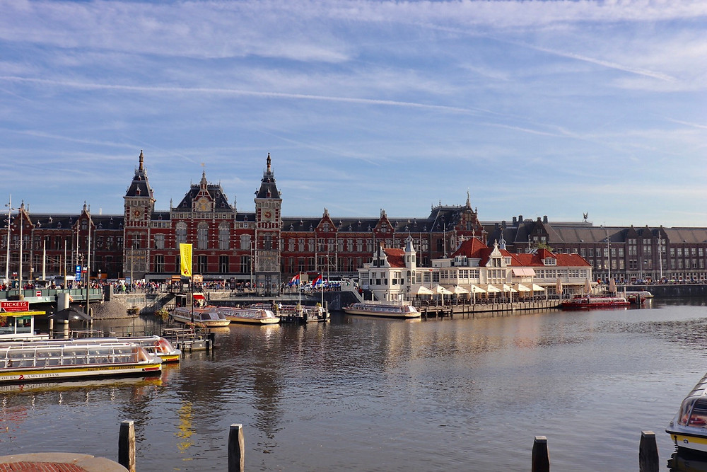 View of Amsterdam central train station over the canals