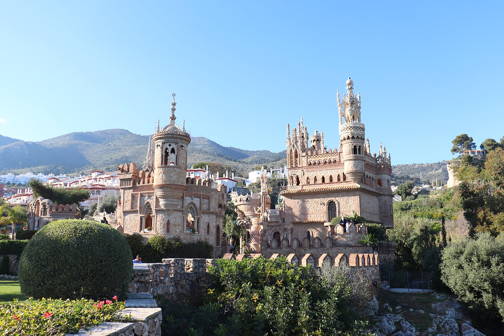 Castillo Monumento Colomares from the outside with hills in the background in Benalmadena, Spain