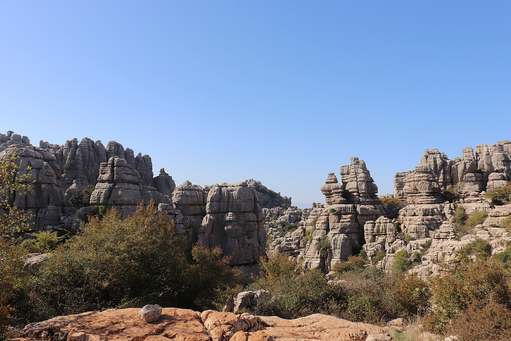 View of the limestone rock formations at El Torcal from a higher platform on a sunny day.