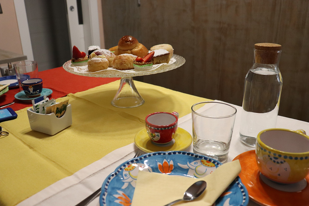 Selection of pastries and drinks on the table for breakfast at B&B Via Toledo 156 Naples Italy