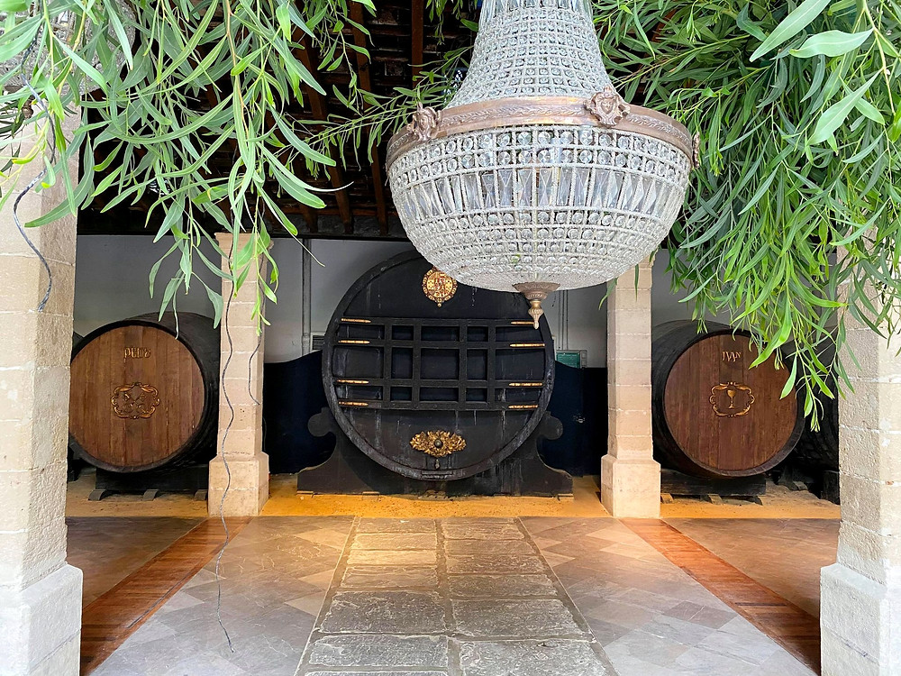 Bodegas Tío Pepe chandelier and royal wine barrel inside the events room in Jerez, Cadiz
