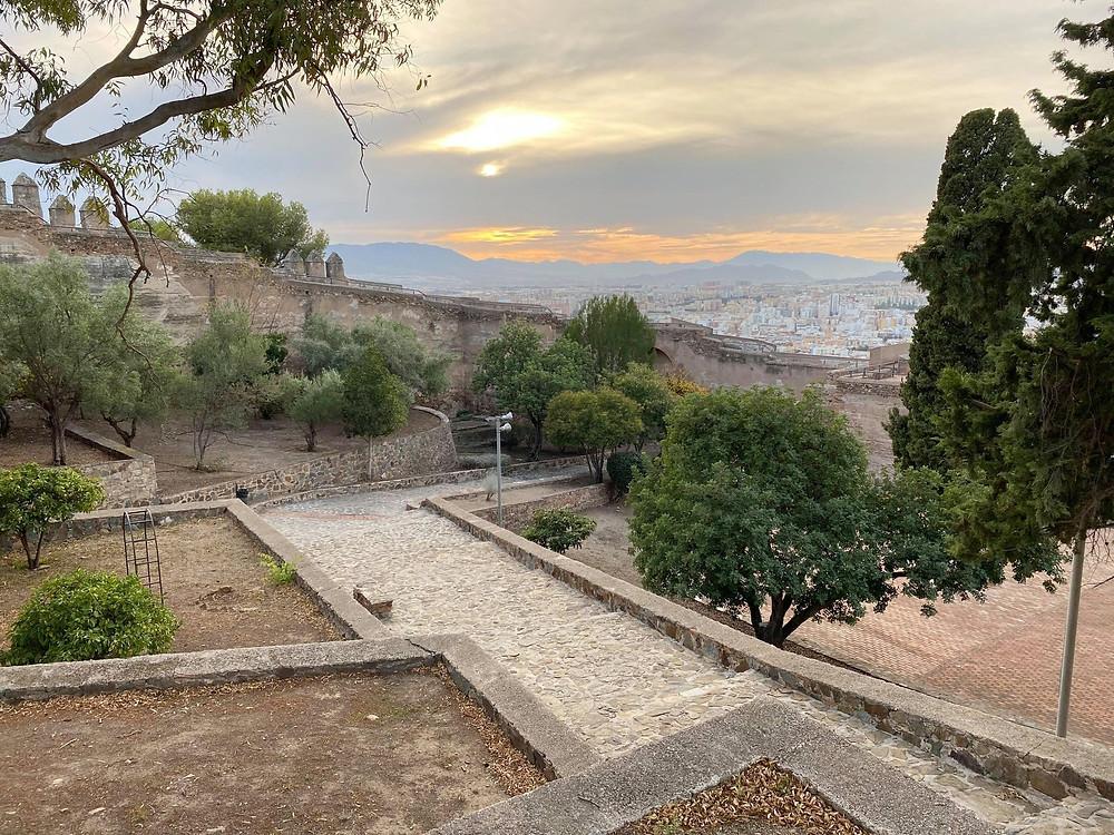 Inside Castillo de Gibralfaro with a sunset view over Malaga, Spain