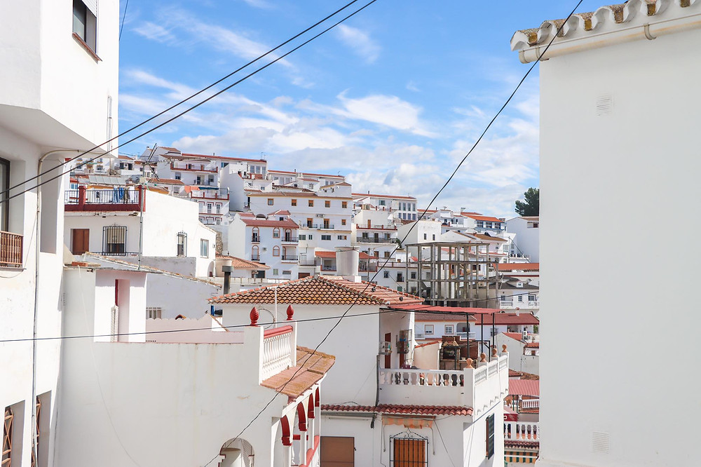 View of the white houses in the village slanting upwards.