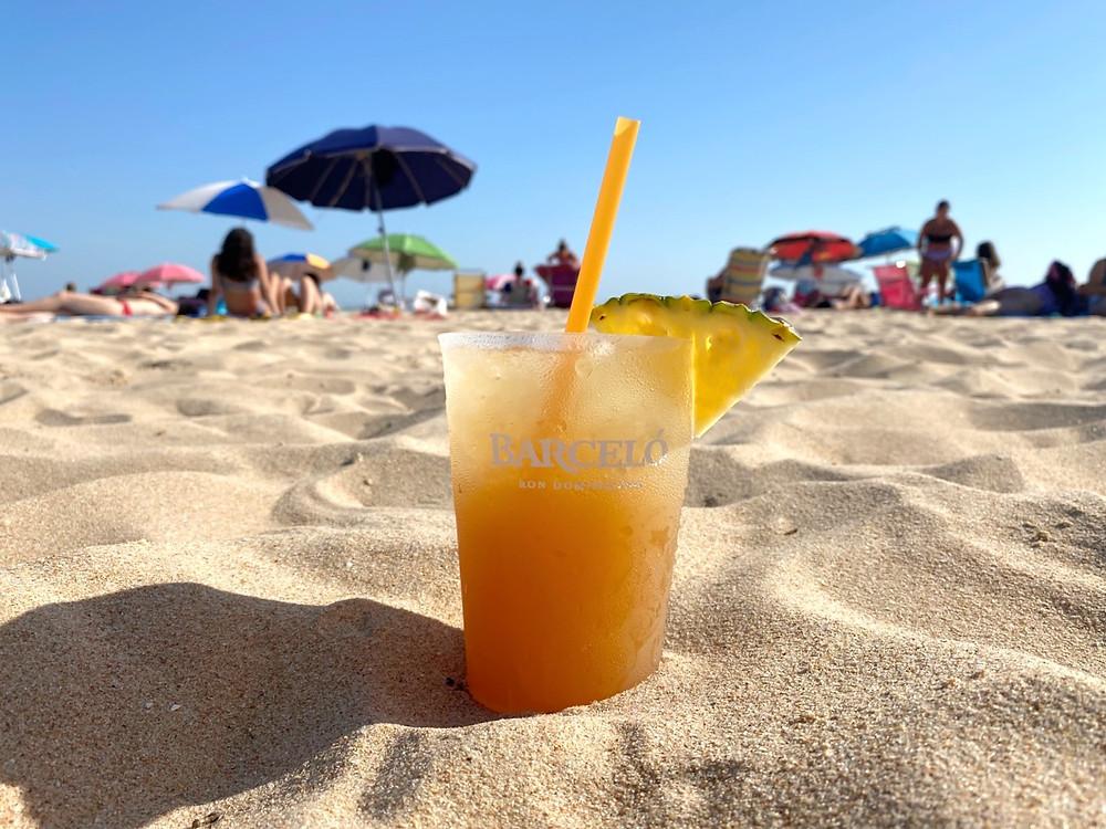 Playa de La Muralla with a cocktail in Puerto Sherry, Cadiz, Spain
