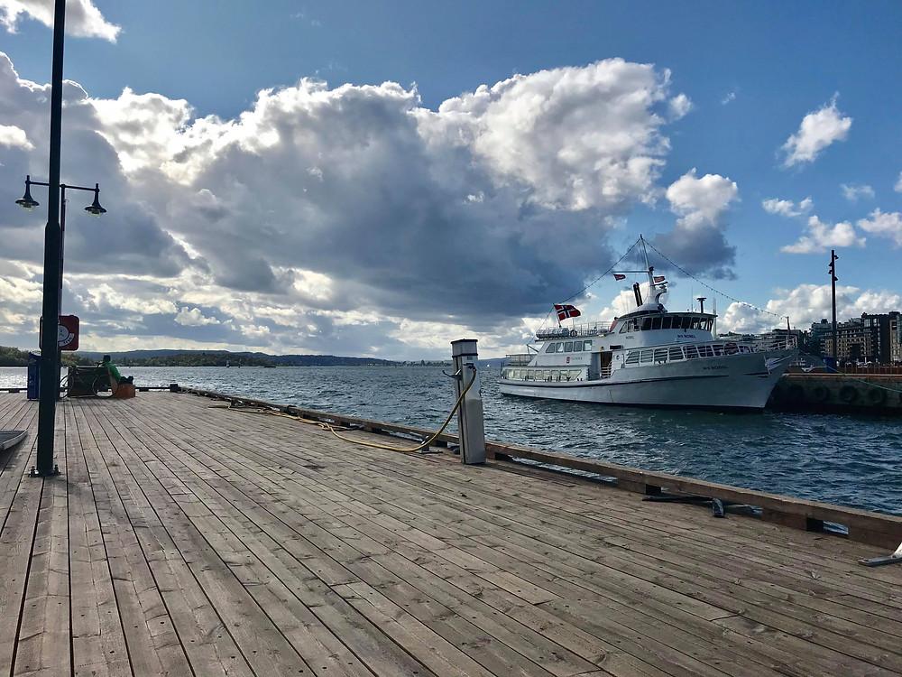Aker Brygge walk along the docks in Oslo, Norway