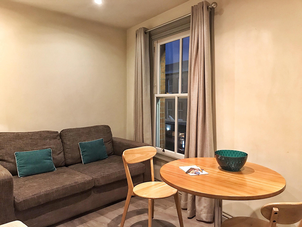 Living room with dining table in Base Serviced Apartments Chester, England