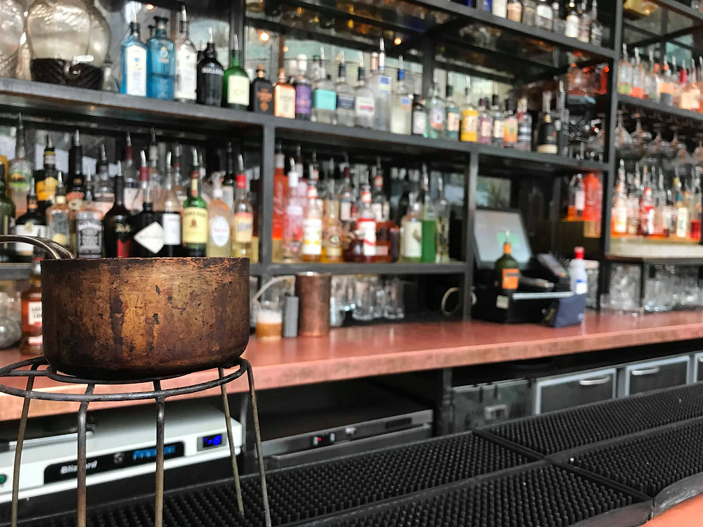 The bar inside The Alchemist in Spinningfields, Manchester England