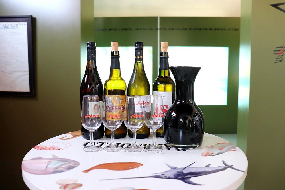 4 bottles of wine with wine glasses for tasting inside Bodegas Barbadillo in Sanlucar de Barrameda, Cadiz