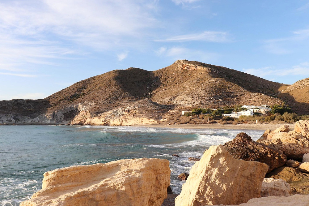 View of Cala del Plomo from the hiking trail in the rocks at sunrise in Almeria, Spain