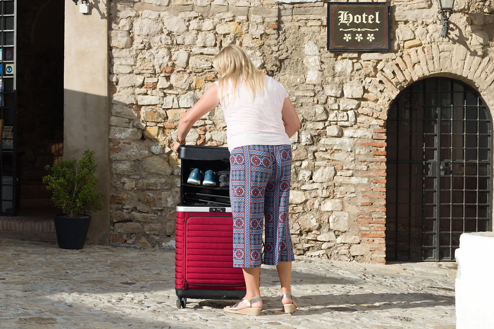 Expanding the Pull Up Suitcase in front of a hotel in Castillo de Castellar, Spain