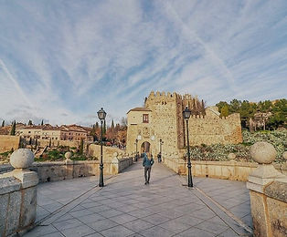 Walking on the Puente de San Martin, Toledo, Spain