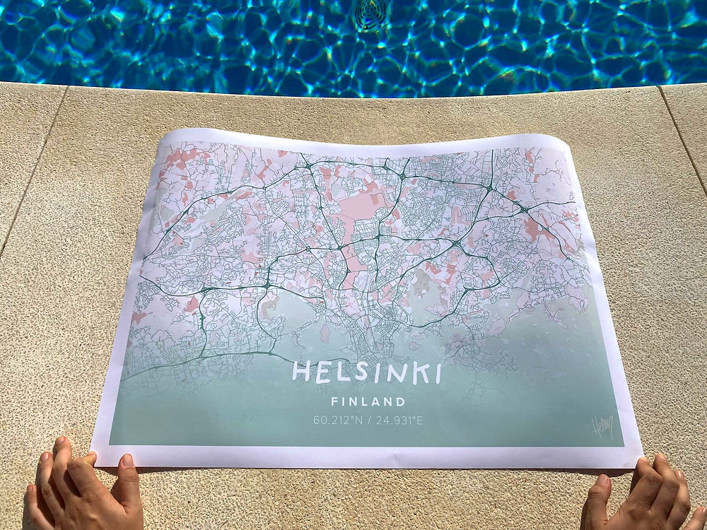 Map poster of Helsinki sitting by the side of the pool