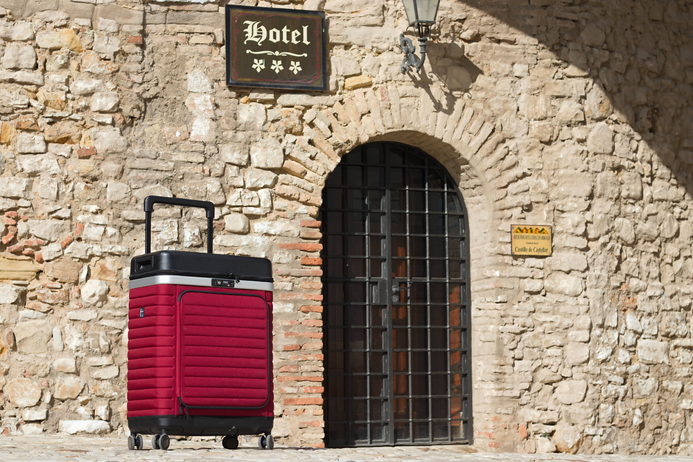 Red Pull Up Case in its closed state outside a hotel in Castillo de Castellar, Spain